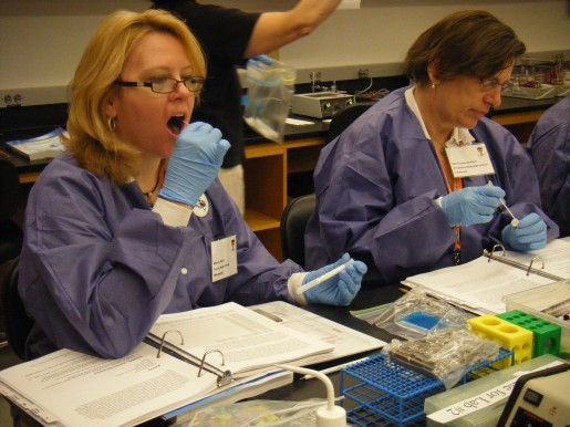 Sherry Davis (left) and lab partner Gail Turner-Graham swab their cheek cells for analysis.