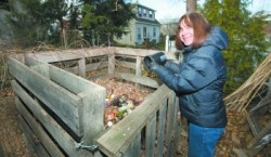 Princeton resident Heidi Fichtenbaum shows off her backyard composting set-up.